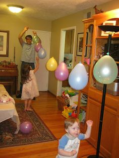 A new spin on a pinata. Single balloons filled with confetti and a few toys and candies. Each child chose one to pop with a pin. Each time was a surprise.