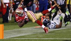 San Francisco 49ers running back Kendall Hunter (L) is tackled near the goal line by Seattle Seahawks' Bobby Wagner, setting up a 49ers field goal, during their NFL football game in San Francisco, California, October 18, 2012. (Reuters)