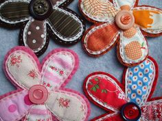 a selection of handmade felt and fabric brooches