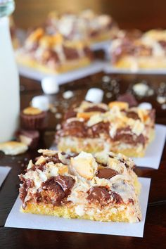 Gooey Ritz Peanut Butter Cup S'mores Bars! Buttery cake topped with marshmallow fluff, mini peanut butter cups and Ritz crackers. If these bars were a person, we'd be married and on our third kid.