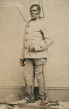 Wilson Chinn, a freed slave from Louisiana, poses with equipment used to punish slaves. Such images were used to set Northern resolve against slaveholders during the American Civil War.