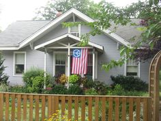 flag hanging on house | Front Porch