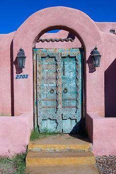 Pink stucco and aqua door..
