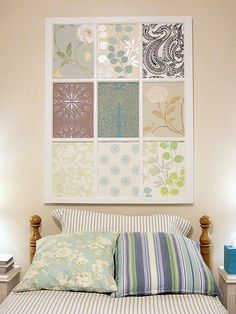 DIY Wall Decor -- old window pane and coordinating scrapbook paper    For best results get the scrapbooking photo corners that will stick to the glass.