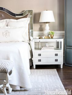 White master bedroom inspiration with monogram.