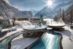 Aqua Dome Thermal Resort -- Langenfeld, Austria.  Each of the three pools (one not shown) here are filled with thermal water from a source 1,800 meters below the ground.  They also have underwater music and lighting effects much like those in a club.