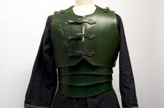 Green leather armour with celtic dragon embossing
