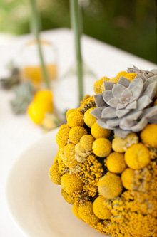 Beautiful yellow and gray centerpiece.