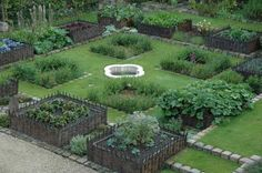 boisricheux : potager garden (like this particular layout w/ fountain) from: http://www.designsponge.com/2010/05/past-present-kitchen-garden-history.html