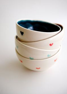 Heart Bowls by RossLab: Thrown on the potter's wheel, and glazed on the inside with bright teal, coral, red, and mint hues to match the dainty hearts on the outside!  ALL OF MY YES! :D