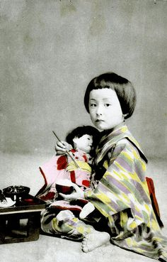 Japanese girl@Meal Time 1910 A little Girl feeding her doll some rice.