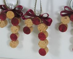 Use wine corks, ribbon, and paint to create adorable candy cane Christmas ornaments #DIY #Corks #Wine