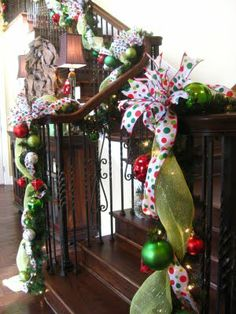 Decorating the staircase!  Love the garlands!!