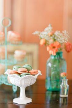 orange + aqua themed shower. macaroons, jars, and cupcake stand.