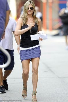 Body confident: showing off her legs on set- Jennifer Aniston