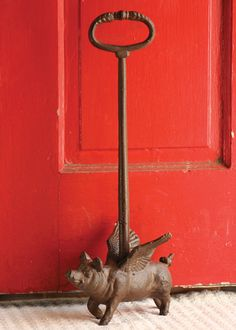 cast iron doorstop \ flying pig   $44.00