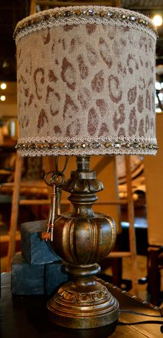 Exotic cheetah print always goes with everything! Bejeweled animal print lamp shade on a bronze base for night stand or desk.