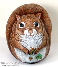 Hand painted rocks.Wildlife animals painted on stone. Squirrel