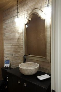 Dark timber vanity, beautiful stone vessel sink, tap to the side.