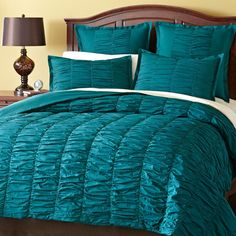 Rows of flowing pleats resemble the gentle ripples of a lazy creek lulling you to sleep