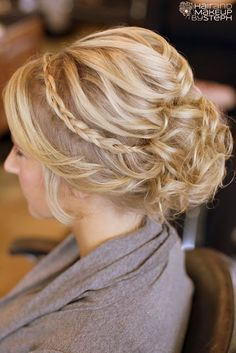 Another 25 Bridal Hairstyles  Wedding Updos | Confetti Daydreams - An updo with wisps of curly hair pulled back into a low bun with perfectly styled curls ♥