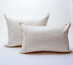 lined paper pillow by pilosale on Etsy. lines are embroidered!