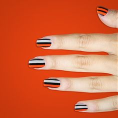 #Emmy Manis: ORANGE IS THE NEW BLACK - Channel your own tough girl cellmate with a bright orange-and-white mani stamped with black stripes (use Sally Hansen's Kook A Mango, Greige, and I Heart Nail Art Pen in black). #SallyHansen from #InStyle