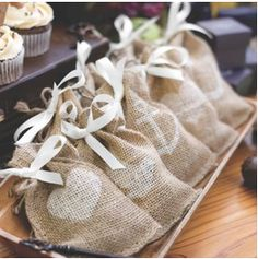 These burlap bags are the perfect sachets for holding rice.