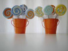 Baby washcloth lollipops - made with 2 washcloths, baby spoon and tape.