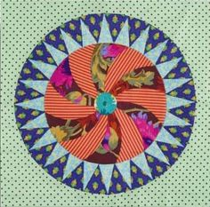 "This is the block, but the link takes you to the TEMPLATES for making the ""cog wheel,"" which I know as the Wheel of Fortune quilt block. Get the templates on the Material Obsession website. Finishes to 19.5"" square."