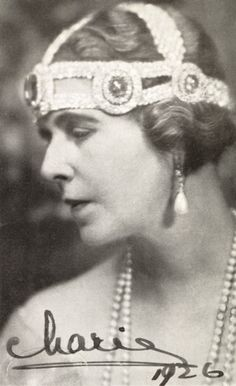 Queen Marie of Roumania 1926 in a rather ugly bandeau with the sapphire elements from the Grand Duchess Vladimir sapphire tiara (these were removable and could be used as brooches, or as here, attached to another head ornament).