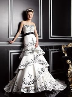 This Jasmine Bridal wedding gown has a detachable skirt. The ivory and black color detail really makes this a unique wedding dress