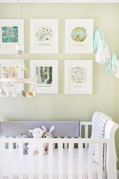 lovely nursery. Love the gallery wall above the crib!