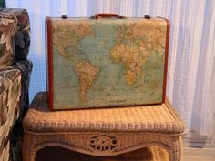 Map covered vintage suitcase, what a great idea for a suitcase that is not very good looking as it is.