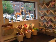 I know it's a dog store but I love the shelves for a play room