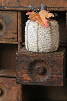 A spool of crochet thread turns into a pumpkin.