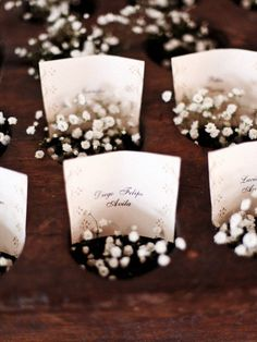 Baby's breath with placement cards. Simple, cheap, and very lovely.