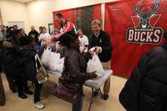 GM John Hammond shares a laugh at the House of Peace as the Bucks hand out Thanksgiving Meals.