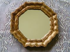 Vintage Gold Ornate Hanging Mirror. $7.00, via Etsy.
