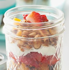 Layer Maple-Almond Granola in a Mason jar with Greek yogurt and fresh berries for a quick and nutritious breakfast on the go.