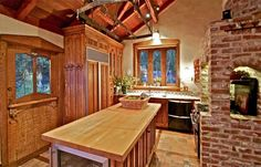 The kitchen features a wood-paneled refrigerator and center island with wine chiller.