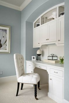 Built-in were painted with Benjamin Moore China White in a satin finish. Wall color: Benjamin Moore, 2135-60 Summer Shower.