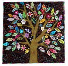 """Make leaves from saved baby clothes are a tree quilt in lieu of conventional quilting squares. """"great idea for baby clothes quilt"""""""