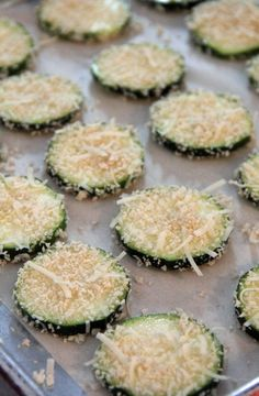 Baked Zucchini Chips Ingredients 1 medium zucchini 1 egg white, lightly beaten 2 Tbsp Parmesan cheese, shredded 1/4 cup Panko crumbs 1/4 tsp garlic powder 1/4 tsp onion powder salt  pepper  Bake at 425 for 20 minutes. Flip each slice over and bake a further 10 - 12 minutes, until nicely browned and crispy. Serve hot.