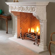 The Fiorenza stone fireplace. It's high and wide, it has a spacious mantel shelf, it's delicately carved.