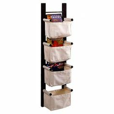 "Espresso-finished magazine rack with 4 canvas baskets. Hangs vertically or horizontally.   Product: Magazine rackConstruction Material: Canvas and woodColor: EspressoFeatures:   Can hang vertically or horizontallyFour baskets provide convenient and attractive storage Dimensions: 44"" H x 12"" W x 7"" D"