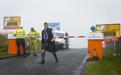 A group of pranksters from both sides of the border staged the construction of a 'Scottish Border Agency' passport control centre at Carter Bar on the Scottish border near Jedburgh.