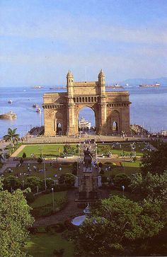 Gateway-of-India, Mumbai, Maharashtra, India. The Gateway of India is a monument built during the British-Raj in Mumbai (formerly Bombay), India. It is located on the waterfront in the Apollo Bunder area, South Mumbai and overlooks the Arabian Sea. The structure is a basalt arch, 26 metres (85 feet) high. It lies at the end of Chhatrapati Shivaji Marg at the water's edge in Mumbai Harbor.
