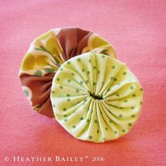 """How to make a fabric yoyo (click the """"back to..."""" link at the top of the page for full tutorial)  Cute for embelishment, but I have seen them stitched together solid for something as large as a quilt! Another great use for scraps in your scrap bin!"""