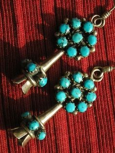 Long Navajo Sterling Silver Turquoise Sunburst by justlooking4now. $228.95. This design looks like Bernard Bowekaty. There's a squash-blossom necklace that matches these.
